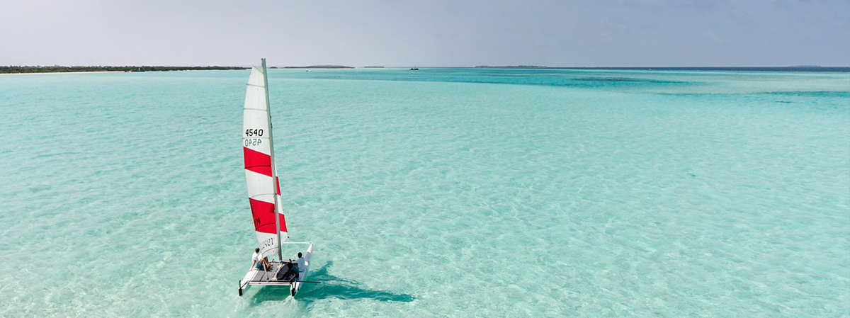 Soneva-Jani-Catamaran-in-lagoon-by_Artefficio-1.jpg